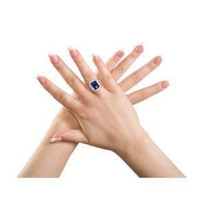 Blue emerald cut sapphire and diamond ring white g